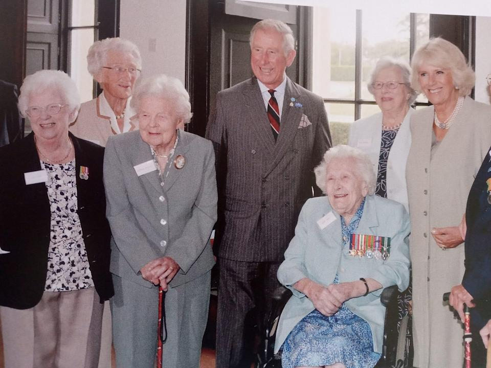 Gladys Eva, far left, meeting the Prince of Wales and the Duchess of Cornwall