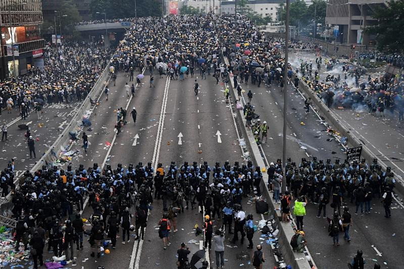 Protesters faced off against police during the huge rally on the streets of Hong Kong (AFP Photo/Anthony WALLACE)
