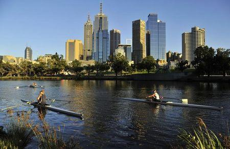 Rowers train at dawn on the Yarra River in Melbourne