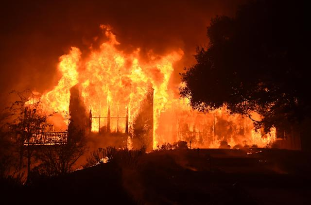 <p>The main building at Paras Vinyards burns in the Mount Veeder area of Napa in Calif., on Oct. 10, 2017. (Photo: Josh Edelson/AFP/Getty Images) </p>