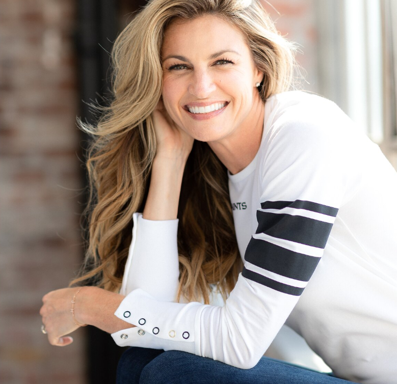 Less is more: This stretch top has team colored stripes on the sleeves and a small screen-printed logo on the front. (Photo: Courtesy of Wear by Erin Andrews)