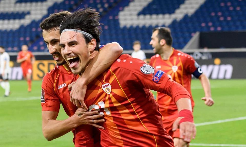 Eljif Elmas is congratulated after scoring North Macedonia's winner away to Germany, with Goran Pandev wearing the captain's armband in the background