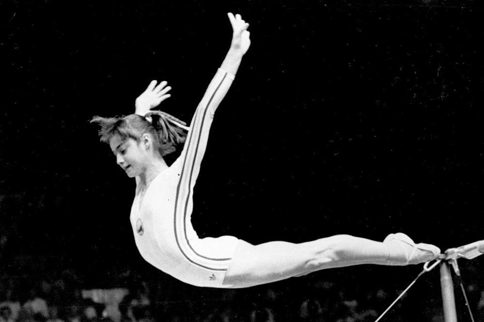 Romania's Nadia Comaneci dismounts from the uneven parallel bars in the women's gymnastics competition at the Olympic Games in Montreal in 1976.