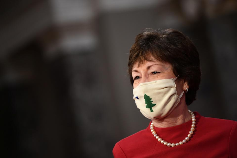 Senator Susan Collins (R-ME) wears a face mask as she participates in a swearing-in for the 117th Congress with Vice President Mike Pence, in the Old Senate Chambers at the U.S. Capitol Building in Washington, DC, U.S.  January 3, 2021. Kevin Dietsch/Pool via REUTERS