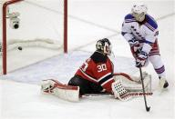 New York Rangers left wing Chris Kreider, right, scores past New Jersey Devils goalie Martin Brodeur during the third period of Game 3 of an NHL hockey Stanley Cup Eastern Conference final playoff series, Saturday, May 19, 2012, in Newark, N.J. (AP Photo/Julio Cortez)