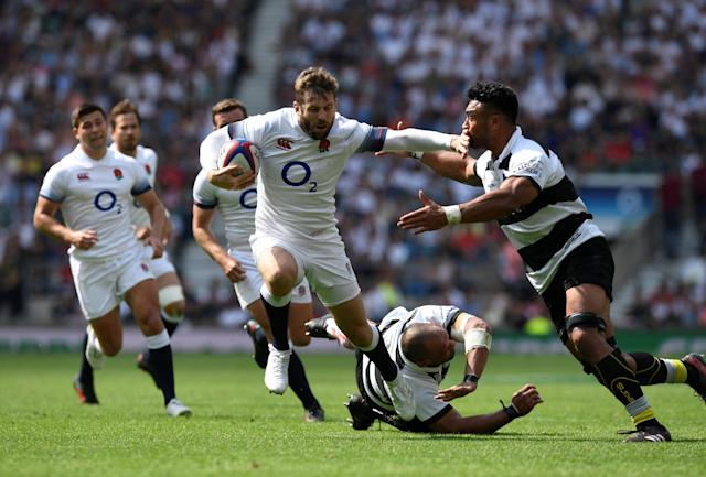 Rugby Union - England v Barbarians, Twickenham Stadium, London, Britain - May 27, 2018 England's Elliot Daly in action with Barbarians' Victor Vito Action Images via Reuters/Tony O'Brien