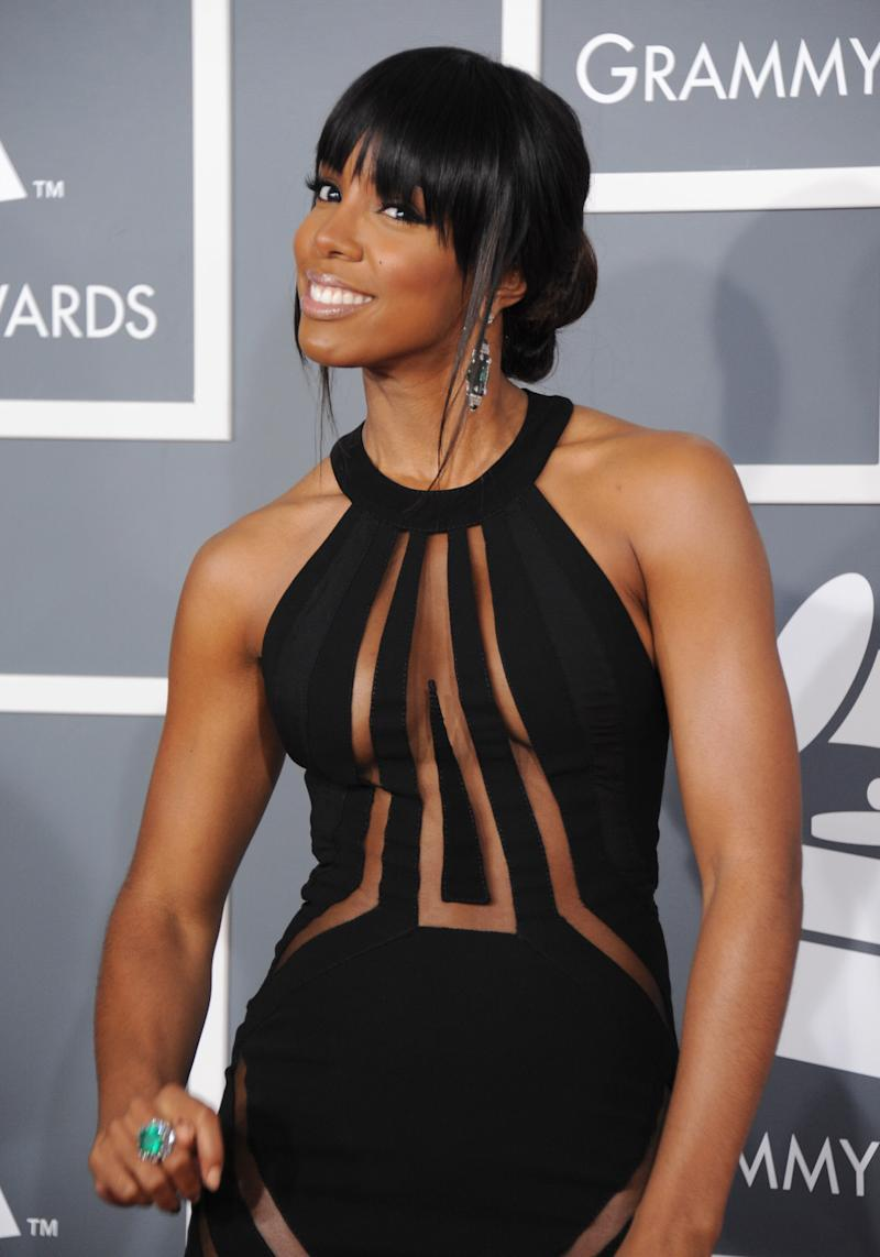 Kelly Rowland arrives at the 55th annual Grammy Awards wearing a dress from the Georges Chakra Couture Collection on Sunday, Feb. 10, 2013, in Los Angeles. (Photo by Jordan Strauss/Invision/AP)