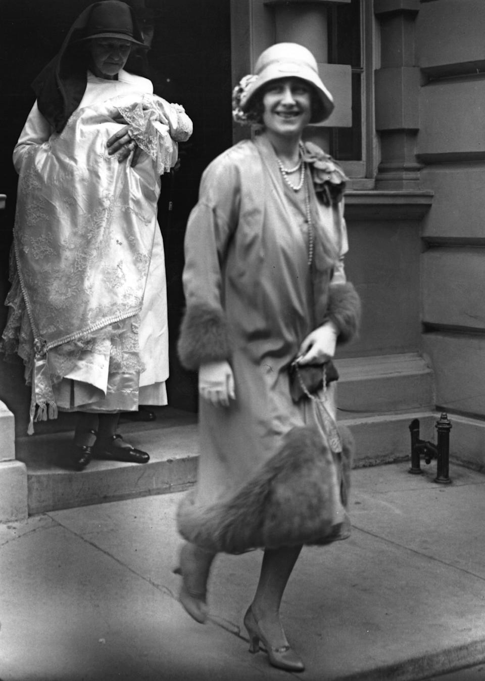 29th May 1926:  The Duchess of York (1900 - 2002) leaving 17 Bruton Street, on her way to the christening of her daughter Princess Elizabeth.  (Photo by E. Bacon/Topical Press Agency/Getty Images)