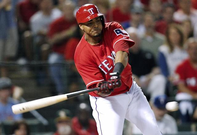 Texas Rangers' Nelson Cruz lines out against the Tampa Bay Rays during the second inning of an American League wild-card tiebreaker baseball game Monday, Sept. 30, 2013, in Arlington, Texas. (AP Photo/Tim Sharp)