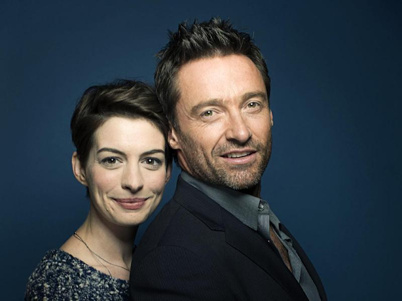 """This Dec. 2, 2012 photo shows actors Anne Hathaway, left, and Hugh Jackman in New York. Hathaway portrays Fantine and Jackman portrays Jean Valjean in the film adaptation of the Victor Hugo novel, """"Les Miserables."""" The film opens on Christmas Day. (Photo by Victoria Will/Invision/AP)"""