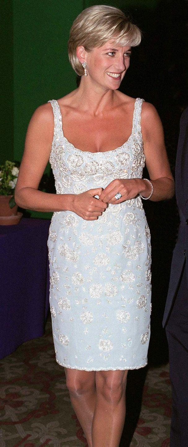 <p>In a light blue dress by Catherine Walker at the Christie's AIDS Crisis Trust and the Royal Marsden Hospital Cancer Fund event in London. </p>