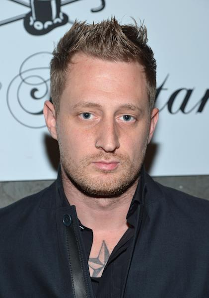 NEW YORK, NY - FEBRUARY 05:  Chef Michael Voltaggio poses for a picture as he Celebrates The New JohnVarvatos.com on February 5, 2013 in New York City, United States.  (Photo by Mike Coppola/Getty Images for John Varvatos)
