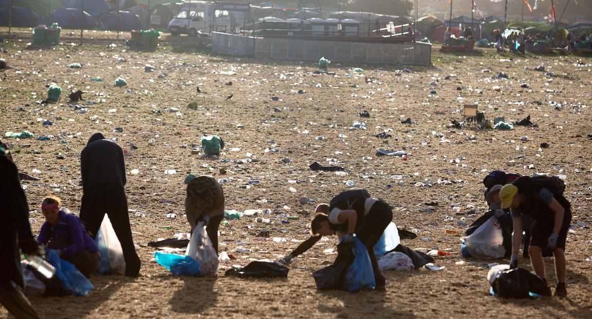 Volunteers clearing up after revellers at the Glastonbury music festival Picture: SWNS)