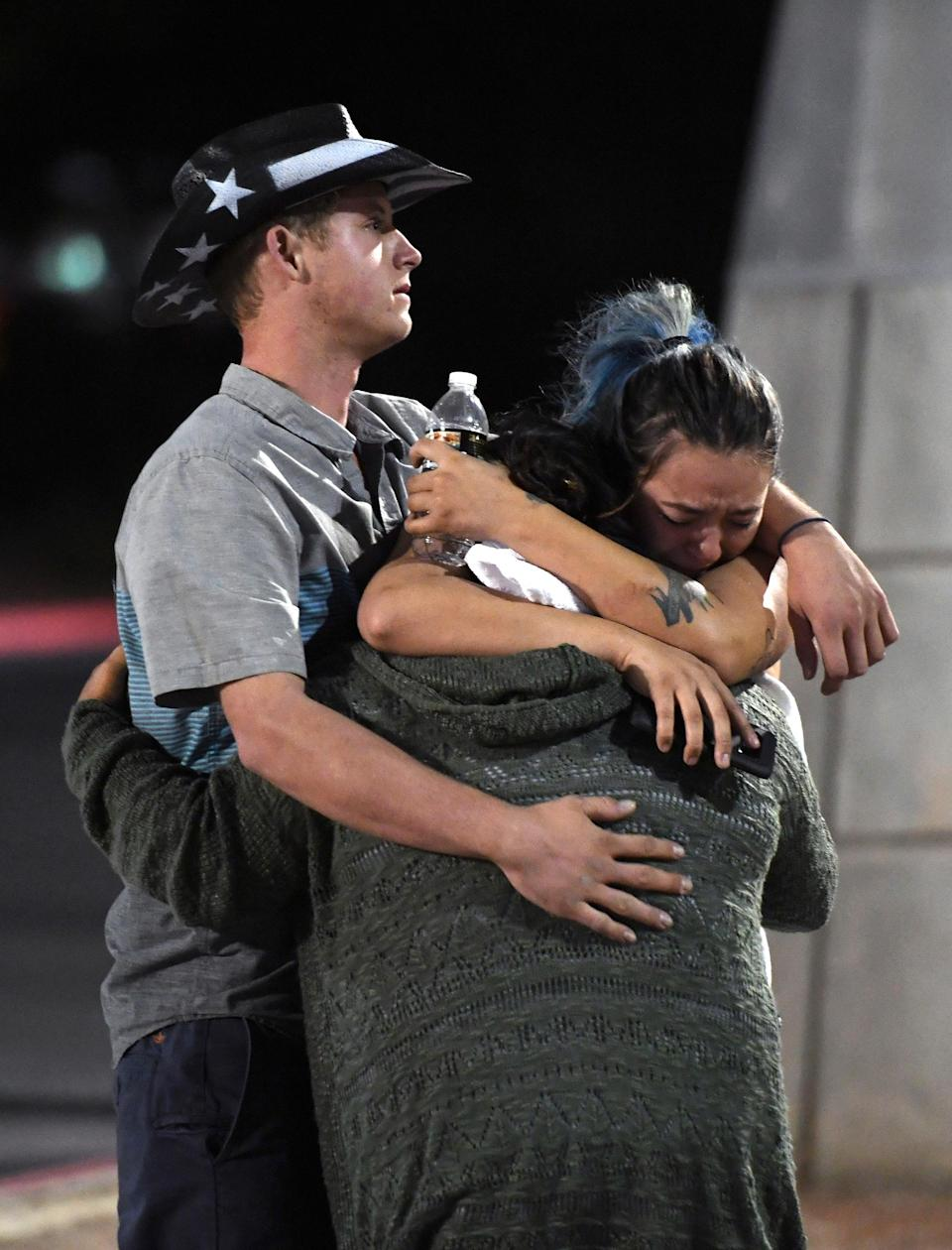 <p>People hug and cry outside the Thomas & Mack Center as the reality of what happened sets in. (Getty) </p>