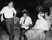 <p>Director Robert Wise chats with actor Christopher Plummer and actress Julie Andrews—who are both in costume—during a lunch break on the set of <em>The Sound of Music.</em></p>