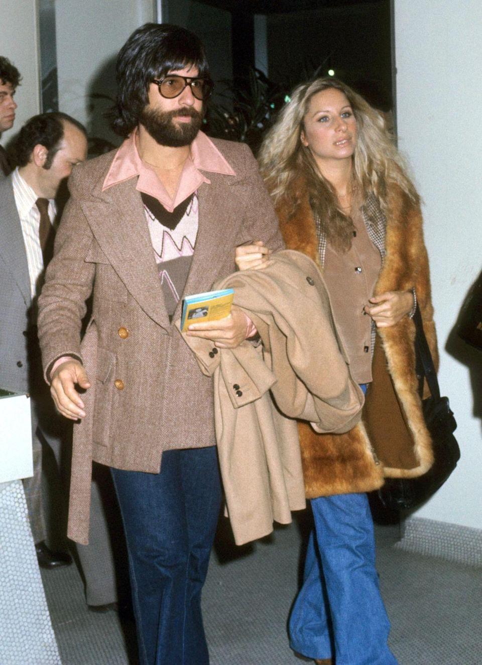 <p>Just a year shy of this former couple's film collaboration <em>A Star is Born</em>, Barbra Streisand and Jon Peters are delivering peak '70s style with a beige-laden outing.</p>
