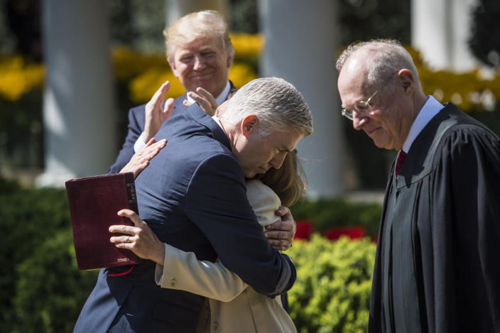 President Donald Trump watches as Supreme Court Justice Neil Gorsuch hugs his wife Marie Louise moments after Supreme Court Justice Anthony Kennedy administered the judicial oath during a swearing-in ceremony in the Rose Garden of the White House in Washington, DC on April 10, 2017. (Photo: Jabin Botsford/The Washington Post via Getty Images)