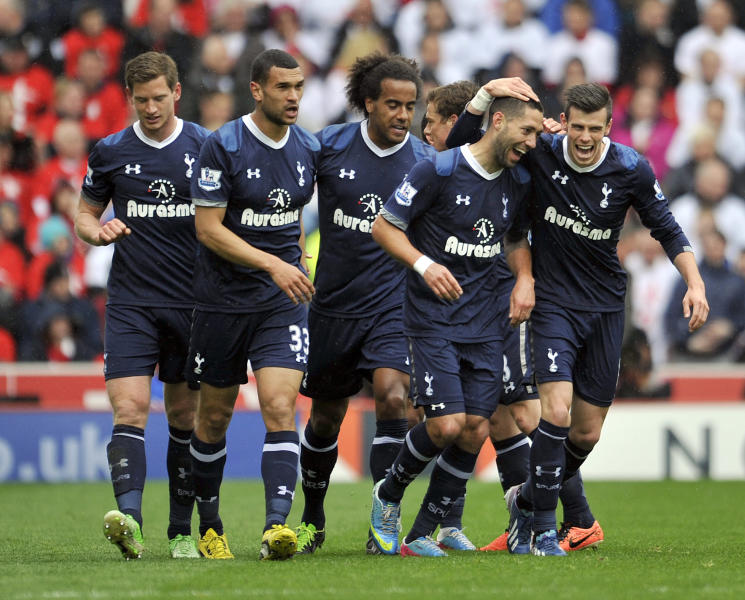 Tottenham Hotspur's Clint Dempsey, second right, celebrates scoring against Stoke City with teammate Gareth Bale, right,during the English Premier League soccer match at the Britannia Stadium, Stoke-on-Trent, England, Sunday May 12, 2013. Tottenham Hotspur won the match 1-2. (AP Photo/PA, Clint Hughes) UNITED KINGDOM OUT NO SALES NO ARCHIVE