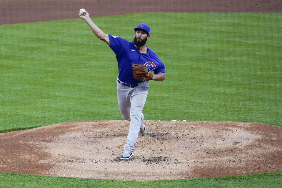 Chicago Cubs starting pitcher Jake Arrieta throws during the first inning of the team's baseball game against the Cincinnati Reds on Friday, April 30, 2021, in Cincinnati. (AP Photo/Jeff Dean)