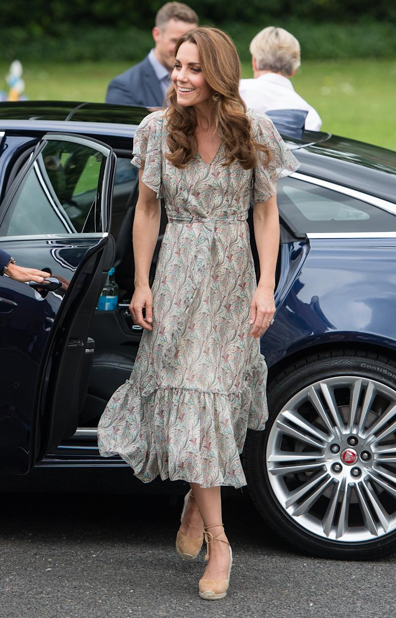KINGSTON, ENGLAND - JUNE 25: Catherine, Duchess of Cambridge joins a photography workshop for Action for Children, run by the Royal Photographic Society at Warren Park on June 25, 2019 in Kingston, England.HRH has today become Patron of The Royal Photographic Society. (Photo by Samir Hussein/WireImage)