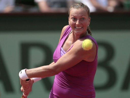 Czech Republic's Petra Kvitova hits a return to Russia's Nina Bratchikova during their French Open match at the Roland Garros stadium in Paris. Kvitova reached the last 16 for the third time but she did it the hard way, serving up eight double faults and committing 37 unforced errors in her 6-2, 4-6, 6-1 win