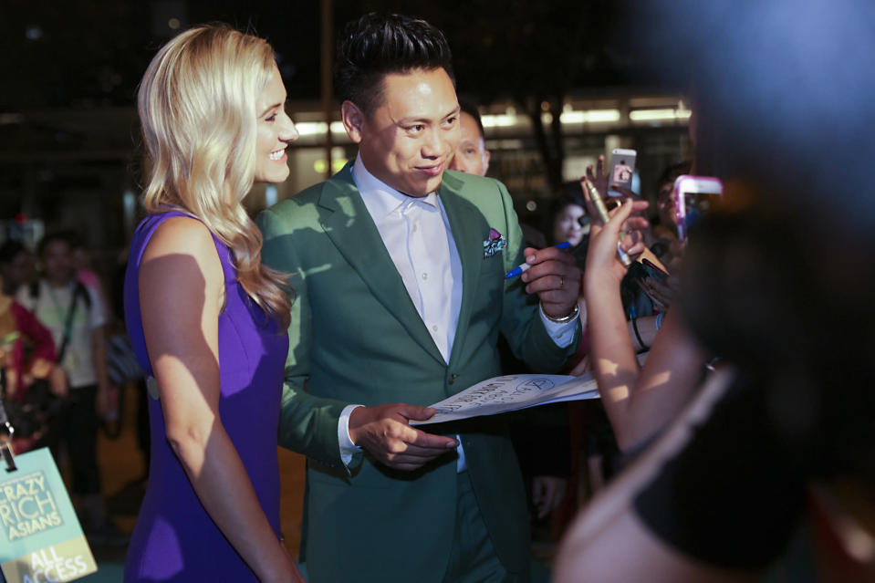 <p>Director Jon M. Chu and wife Kristin Hodge meeting fans during the Singapore premiere of 'Crazy Rich Asians', on 21 August 2018. (PHOTO: Yahoo Lifestyle Singapore) </p>