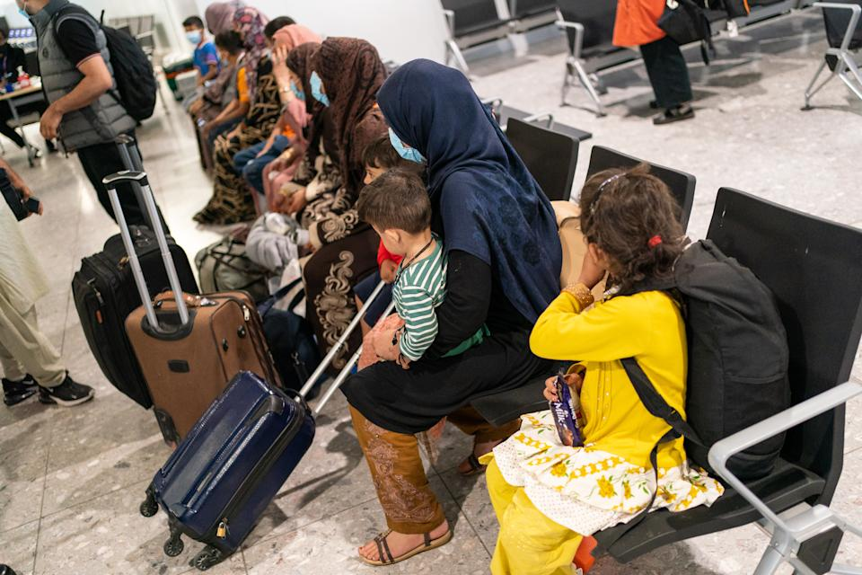 LONDON, ENGLAND - AUGUST 26: Refugees from Afghanistan wait to be processed after arriving on a evacuation flight at Heathrow Airport on August 26, 2021 in London, England. Ministry of Defence figures put the number of people evacuated by the UK since August 13 at 9,226, but there are thousands feared to be remaining. Foreign Secretary Dominic Raab has said the UK will use