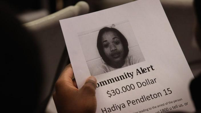 In this Feb. 2013 photo, a Chicago resident looks over a reward flyer at a community meeting inspired by the death of Hadiya Pendleton, a 15-year-old high school honor student shot and killed while hanging out with friends on a rainy afternoon. (Photo by Scott Olson/Getty Images)