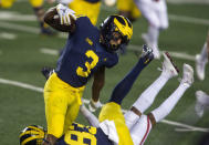 Michigan wide receiver A.J. Henning (3) rushes around a block by tight end Erick All (83) during the first quarter of the team's NCAA college football game against Wisconsin in Ann Arbor, Mich., Saturday, Nov. 14, 2020. (AP Photo/Tony Ding)