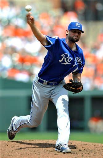 Kansas City Royals starting pitcher Luke Hochevar delivers against the Baltimore Orioles during the second inning of a baseball game, Sunday, May 27, 2012, in Baltimore. (AP Photo/Gail Burton)