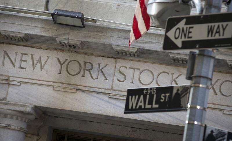 A Wall St. sign is seen outside the entrance of NYSE
