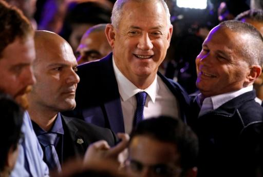 Blue and White's leader, ex-military chief Benny Gantz (C), admitted 'disappointment' with the result
