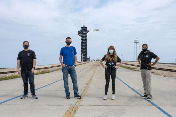 FILE - In this photo provided by SpaceX, Chris Sembroski, from left to right, Jared Isaacman, Hayley Arceneaux and Sian Proctor pose for a photo, Monday, March 29, 2021, at the SpaceX launch pad at NASA's Kennedy Space Center at Cape Canaveral, Fla. Their private flight is scheduled for September 2021. (SpaceX via AP)