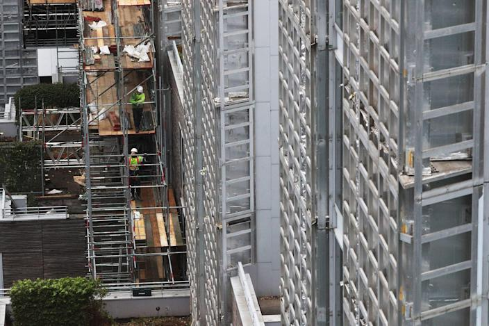 Contractors undertake works at a residential property in Paddington as part of a project to remove and replace non-compliant cladding (PA)