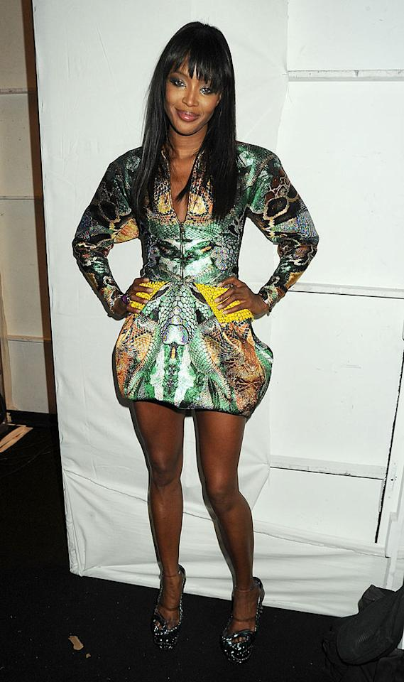 "Speaking of smoking hot supermodels, what do you think of Naomi Campbell's snake print puffball dress? Hot or not? Dave M. Benett/FFR/<a href=""http://www.gettyimages.com/"" target=""new"">GettyImages.com</a> - February 12, 2010"