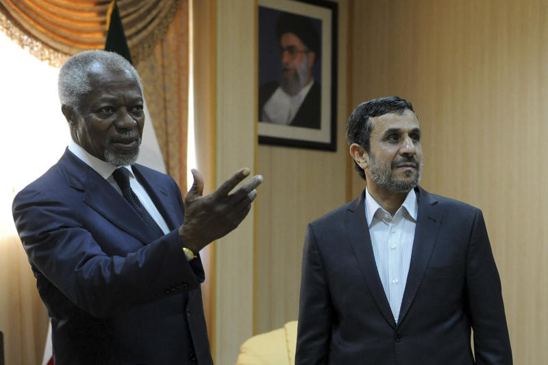 """In this photo released by the semi-official Iranian Students News Agency (ISNA), International envoy Kofi Annan, left, gestures during his meeting with Iranian President Mahmoud Ahmadinejad, on the Iranian island of Qeshm, Wednesday, April 11, 2012. Annan, the U.N.-Arab League envoy, has been pushing Damascus to withdraw its troops from cities and halt all violence in 48 hours to salvage his peace plan. He has appealed to Syria's key ally Iran to support his plan to end the violence wracking the Arab country, saying that """"any further militarization of the conflict would be disastrous.""""  (AP Photo/ISNA, Hamid Foroutan)"""