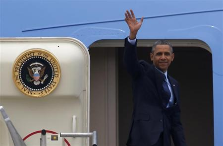 U.S. President Barack Obama waves before boarding Air Force One at Osan Air Base in Pyeongtaek
