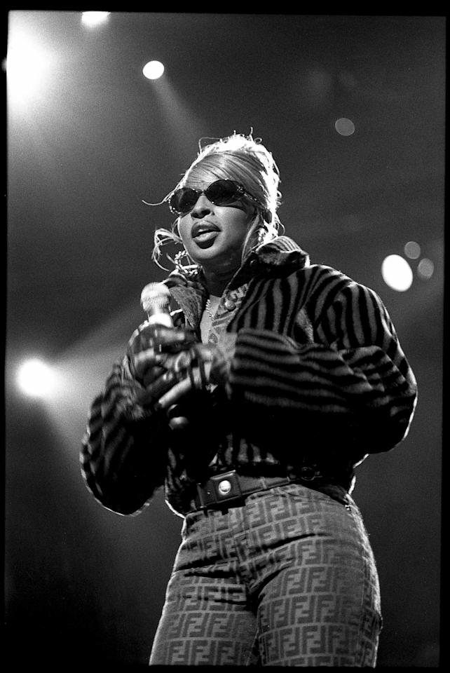 <p>Mary J. Blige performs on stage at Madison Square Garden in 1995 wearing Fendi pants and a striped fur coat.</p>
