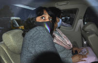Climate activist Disha Ravi, 22, being taken to a court in New Delhi, India, Monday, Feb. 22, 2021. Ravi was arrested for circulating a document on social media supporting months of massive protests by farmers in India. (AP Photo/Dinesh Joshi)
