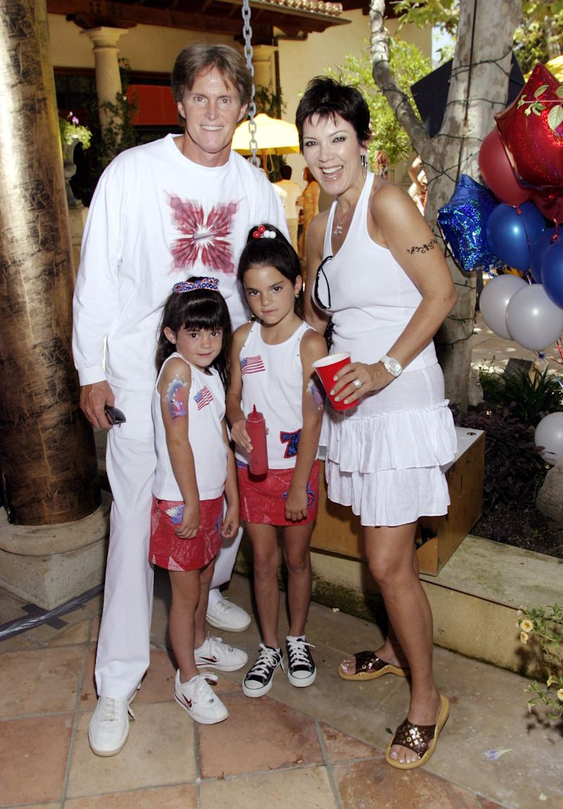 Bruce Jenner and wife Kris with daughters Kylie and Kendall (Photo by Cesare Bonazza/WireImage)