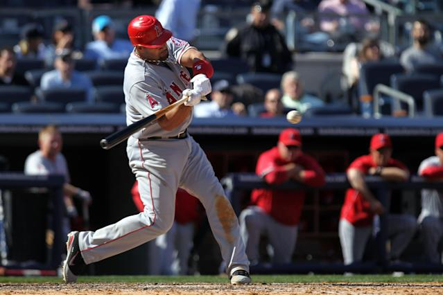 NEW YORK, NY - APRIL 13: Albert Pujols #5 of the Los Angeles Angels grounds into a double play in the ninth inning against the New York Yankees during the home opener at Yankee Stadium on April 13, 2012 in the Bronx borough of New York City. (Photo by Nick Laham/Getty Images)