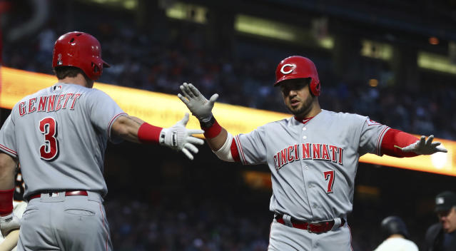 Cincinnati Reds' Eugenio Suarez, right, celebrates with Scooter Gennett (3) after hitting a two-run home run off San Francisco Giants' Ty Blach during the third inning of a baseball game Tuesday, May 15, 2018, in San Francisco. (AP Photo/Ben Margot)