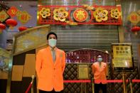 Security guards stand outside the closed Grand Lisboa casino, following the coronavirus outbreak in Macau
