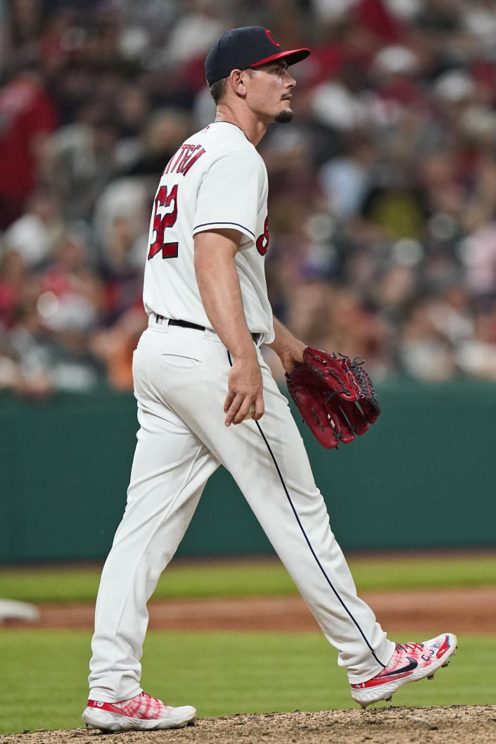 Cleveland Indians relief pitcher Nick Wittgren waits for Tampa Bay Rays' Ji-Man Choi to run the bases on a three-run home run in the ninth inning of a baseball game Friday, July 23, 2021, in Cleveland. (AP Photo/Tony Dejak)