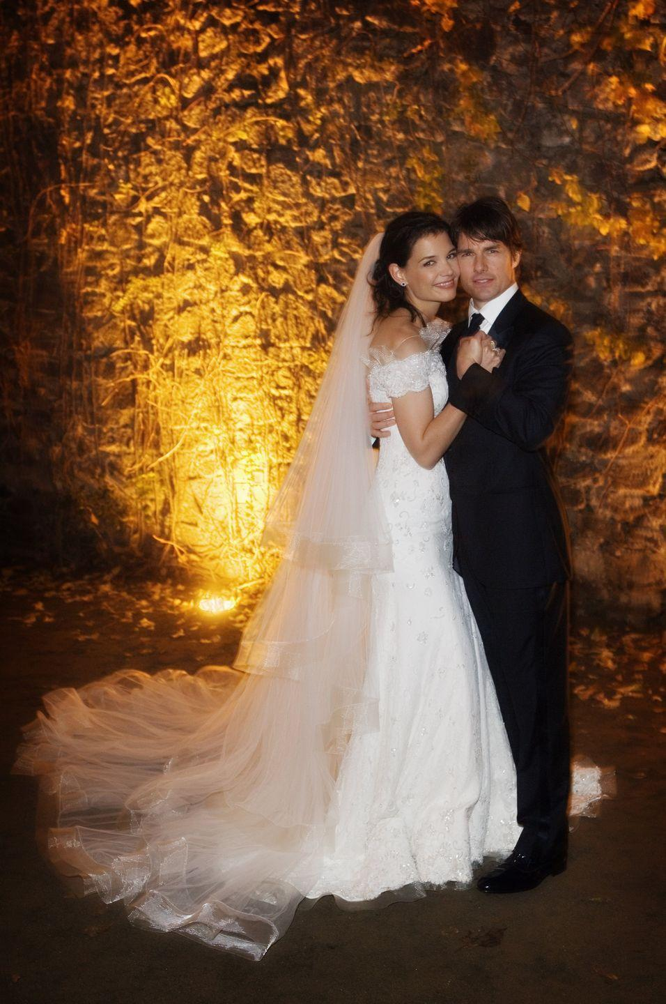 """<p>On November 18, Tom Cruise and Katie Holmes threw a $3.5 million wedding at Castello Odescalchi in Bracciano, near Rome, Italy. The lavish wedding topped off a seriously dramatic courtship: The couple had been dating only about two months before they married, and one month before the wedding, Cruise jumped for joy over his love for Holmes on Oprah's couch in one of his most famous interviews. Katie divorced Tom in 2012, allegedly due to his involvement in Scientology, and took primary custody of their daughter, <a href=""""https://www.goodhousekeeping.com/life/news/a43380/suri-cruise-looks-like-katie-holmes-mini-me-new-photo/"""" rel=""""nofollow noopener"""" target=""""_blank"""" data-ylk=""""slk:Suri"""" class=""""link rapid-noclick-resp"""">Suri</a>.</p>"""
