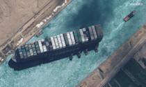 This satellite image released by Maxar Technologies shows the operation of tugboats dislodging the MV Ever Given container ship