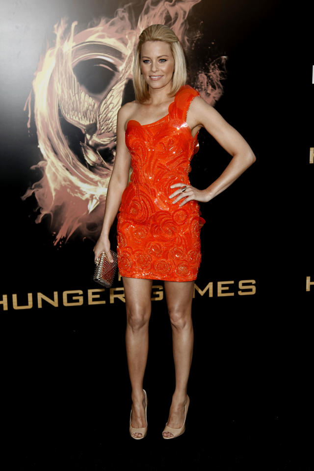 """Elizabeth Banks arrives at the world premiere of """"The Hunger Games"""" on Monday March 12, 2012 in Los Angeles. (AP Photo/Matt Sayles)"""
