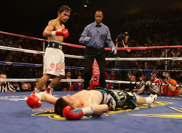 Manny Pacquiao, left, starched Ricky Hatton in their light-welterweight contest (Dave Thompson/PA)