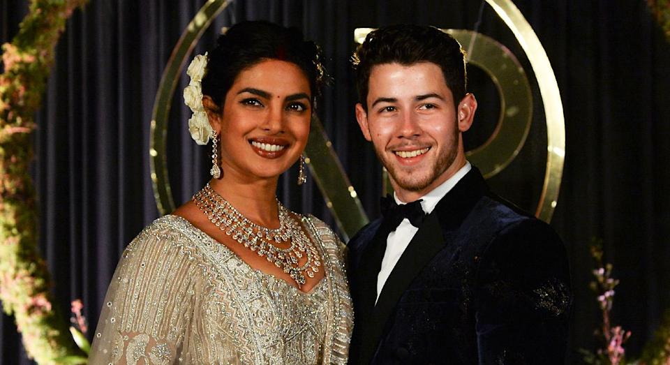 Priyanka Chopra and Nick Jonas pictured at their wedding reception on Tuesday. [Photo: Getty]