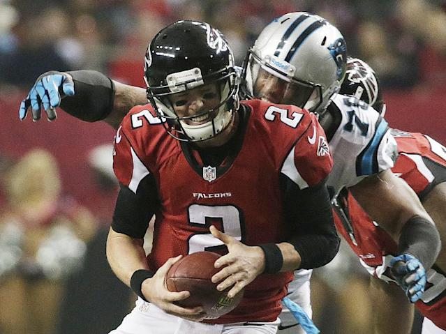 Atlanta Falcons quarterback Matt Ryan (2) is sacked by Carolina Panthers guard Nate Chandler (78) during the first half of an NFL football game, Sunday, Dec. 29, 2013, in Atlanta. (AP Photo/Dave Martin)